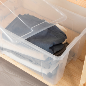 use clear storage bins for organized closet storage